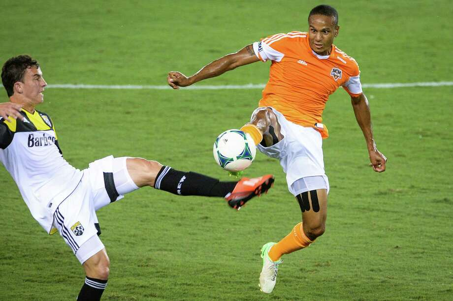 Houston Dynamo midfielder Ricardo Clark (13) fights for the ball against Columbus Crew midfielder Bernardo Anor (7) during the first half of MLS soccer match on Saturday, Aug. 3, 2013, at BBVA Compass Stadium in Houston. Photo: Smiley N. Pool, Houston Chronicle / © 2013  Houston Chronicle
