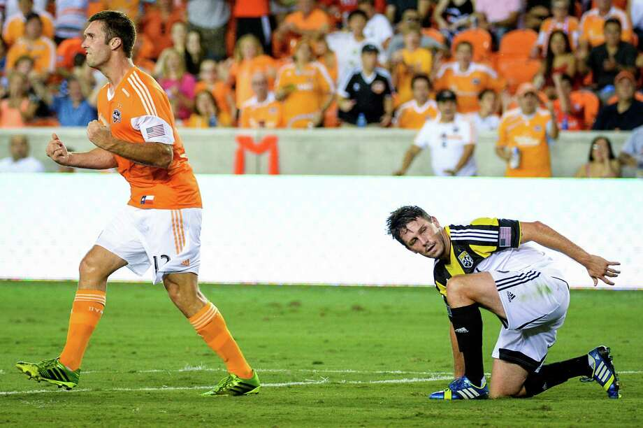 Houston Dynamo forward Will Bruin (12) celebrates after scoring past Columbus Crew defender Danny O'Rourke (5) during the first half of MLS soccer match on Saturday, Aug. 3, 2013, at BBVA Compass Stadium in Houston. Photo: Smiley N. Pool, Houston Chronicle / © 2013  Houston Chronicle