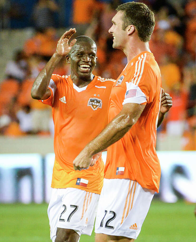 Houston Dynamo midfielder Boniek Garcia (27) and forward Will Bruin (12) celebrate after Bruin scored during the first half of MLS soccer match against the Columbus Crew on Saturday, Aug. 3, 2013, at BBVA Compass Stadium in Houston. Photo: Smiley N. Pool, Houston Chronicle / © 2013  Houston Chronicle