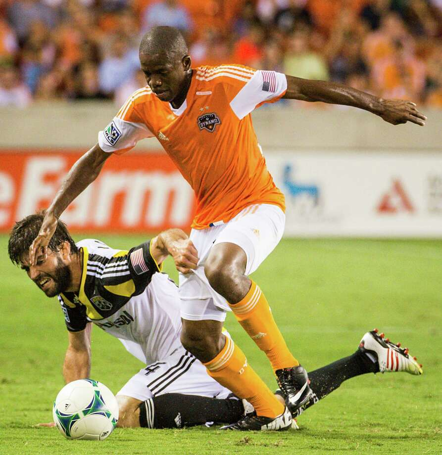 Houston Dynamo midfielder Boniek Garcia (27) is fouled by Columbus Crew defender Agustin Viana (24) during the first half of MLS soccer match on Saturday, Aug. 3, 2013, at BBVA Compass Stadium in Houston. Photo: Smiley N. Pool, Houston Chronicle / © 2013  Houston Chronicle