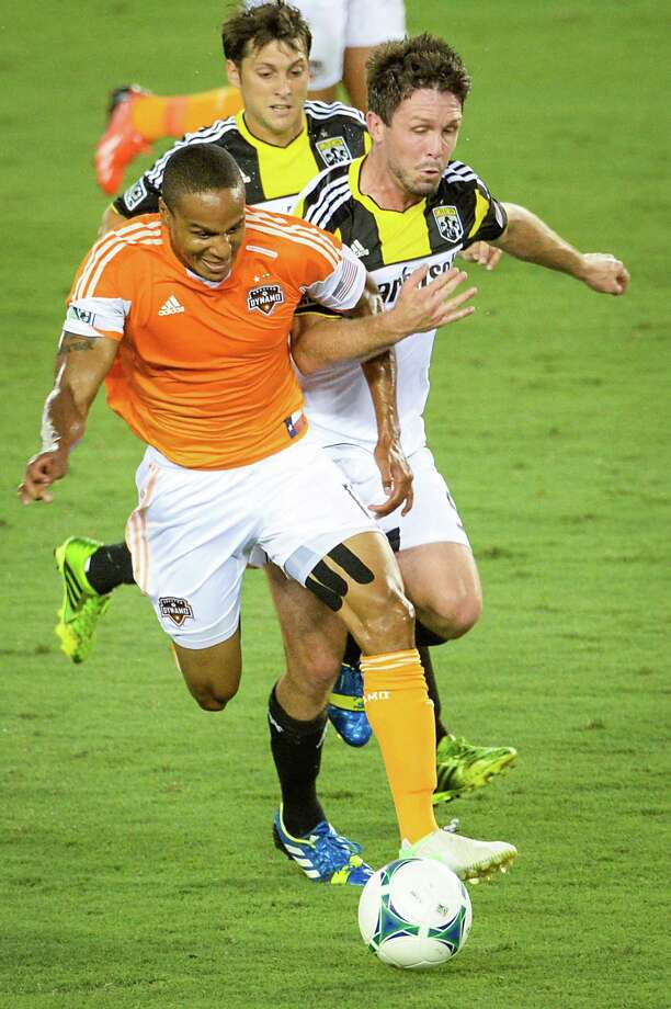 Houston Dynamo midfielder Ricardo Clark (13) tangles with Columbus Crew defender Danny O'Rourke (5) during the first half of MLS soccer match on Saturday, Aug. 3, 2013, at BBVA Compass Stadium in Houston. Photo: Smiley N. Pool, Houston Chronicle / © 2013  Houston Chronicle