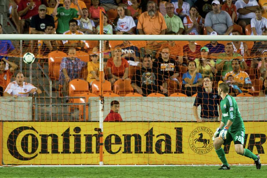 Columbus Crew goalkeeper Matt Lampson watches a shot by Houston Dynamo forward Cam Weaver go into the net for a goal during the second half of MLS soccer match on Saturday, Aug. 3, 2013, at BBVA Compass Stadium in Houston. The Dynamo won the game 3-1. Photo: Smiley N. Pool, Houston Chronicle / © 2013  Houston Chronicle
