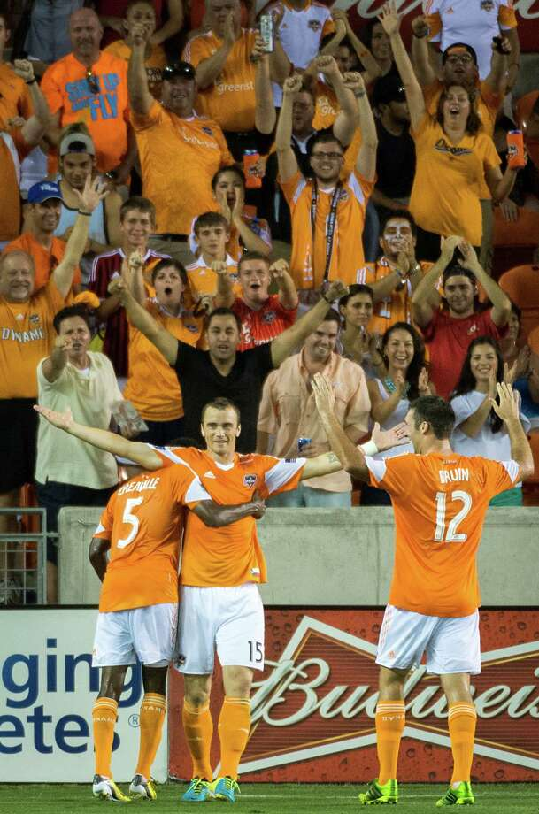 Houston Dynamo forward Cam Weaver (15) celebrates with defender Warren Creavalle (5) and forward Will Bruin (12) after scoring in the 85th minute of an MLS soccer match on Saturday, Aug. 3, 2013, at BBVA Compass Stadium in Houston. The Dynamo won the game 3-1. Photo: Smiley N. Pool, Houston Chronicle / © 2013  Houston Chronicle