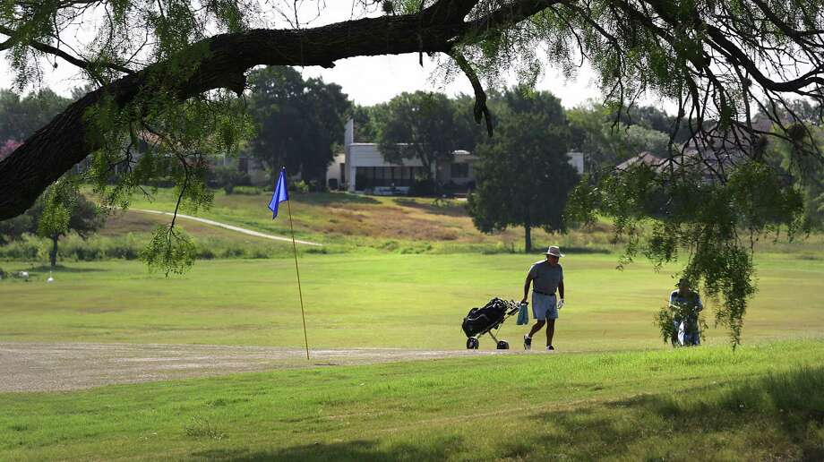 Dan Hernandez (left) and golfing buddy George Herbel walk up to the Woodlake Golf Club's 12th green. Hernandez has played the course since 1989. Photo: Top: San Antonio Express-News / File Photo; Above: Bob Owen / San Antonio Express-News