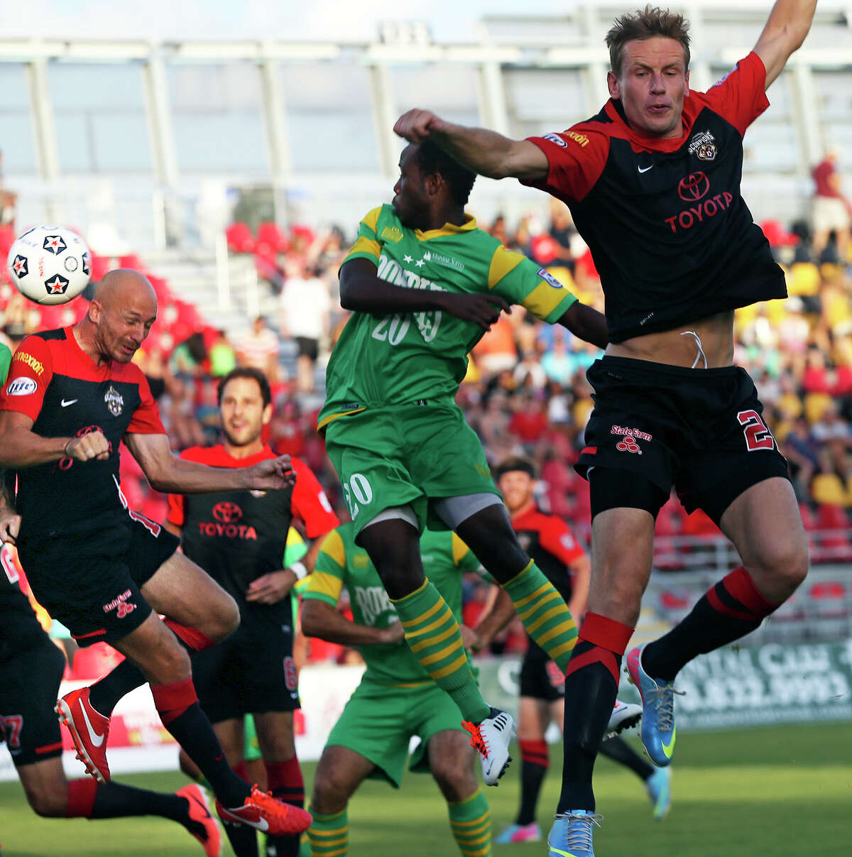 Tomasz Zahorski (right) lets the sidekick fly into Hans Denissen who heads it for his first goal as the San Antonio Scorpions play the Tampa Bay Rowdies at Toyota Field on August 3, 2013.