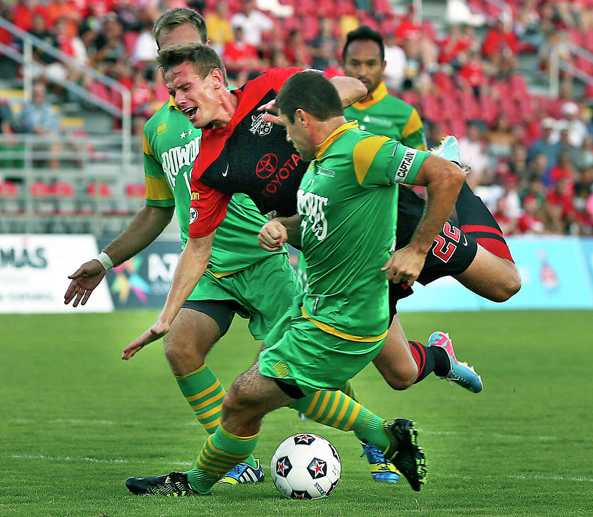 Tomasz Zahorski is stopped by a tackle in front of the goal as the San Antonio Scorpions play the Tampa Bay Rowdies at Toyota Field on August 3, 2013.