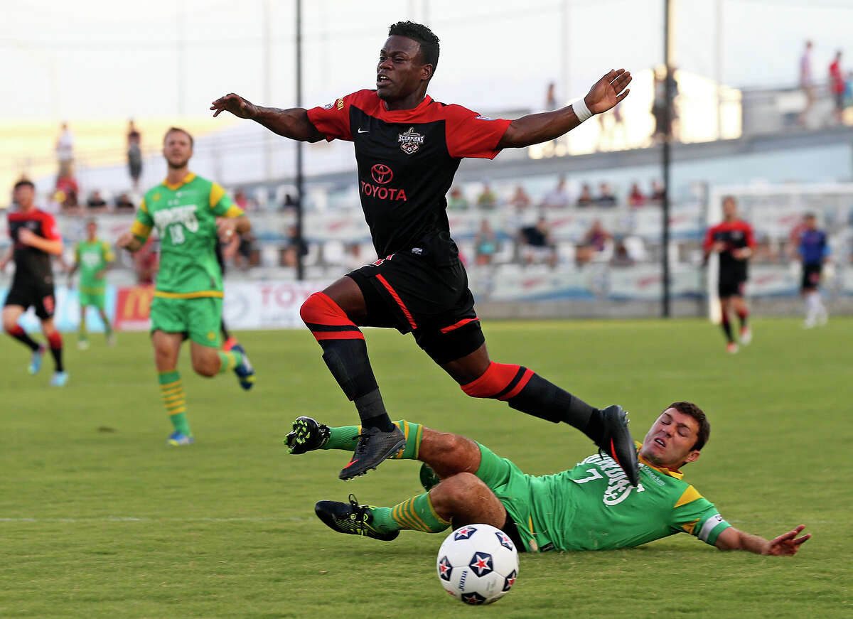 Walter Ramirez gets foiled on a run at the goal by Frankie Sanfilippo as the San Antonio Scorpions play the Tampa Bay Rowdies at Toyota Field on August 3, 2013.