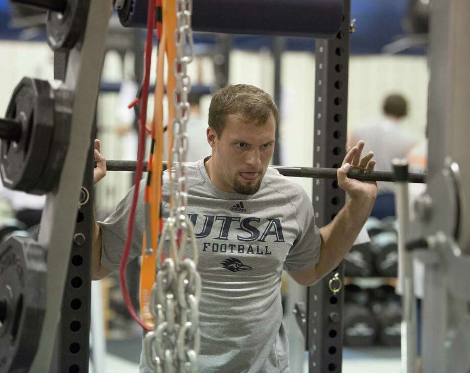 Roadrunners linebacker Dalton Miller, a Warren High alum, works out during an offseason training session over the weekend heading into the start of camp Sunday. Photo: Darren Abate / For The Express-News