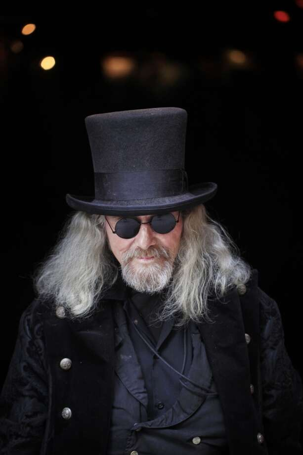 """Outside Specs Bar in North Beach Patrick """"Captain Cool"""" LeBold shows of his usual look that is always completed with a top hat. Photo: The Chronicle"""
