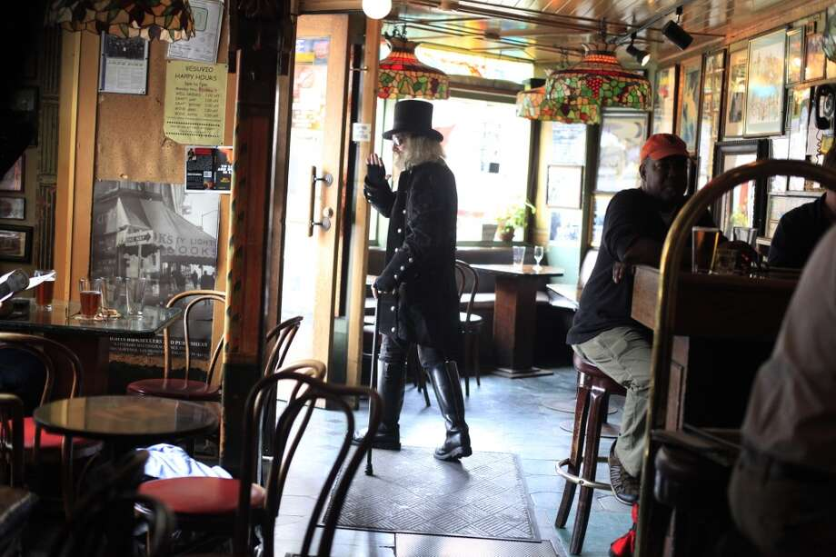 "Before the evening crowds show, Patrick ""Captain Cool"" LeBold makes his exit at Vesuvio Cafe in North Beach. Photo: The Chronicle"