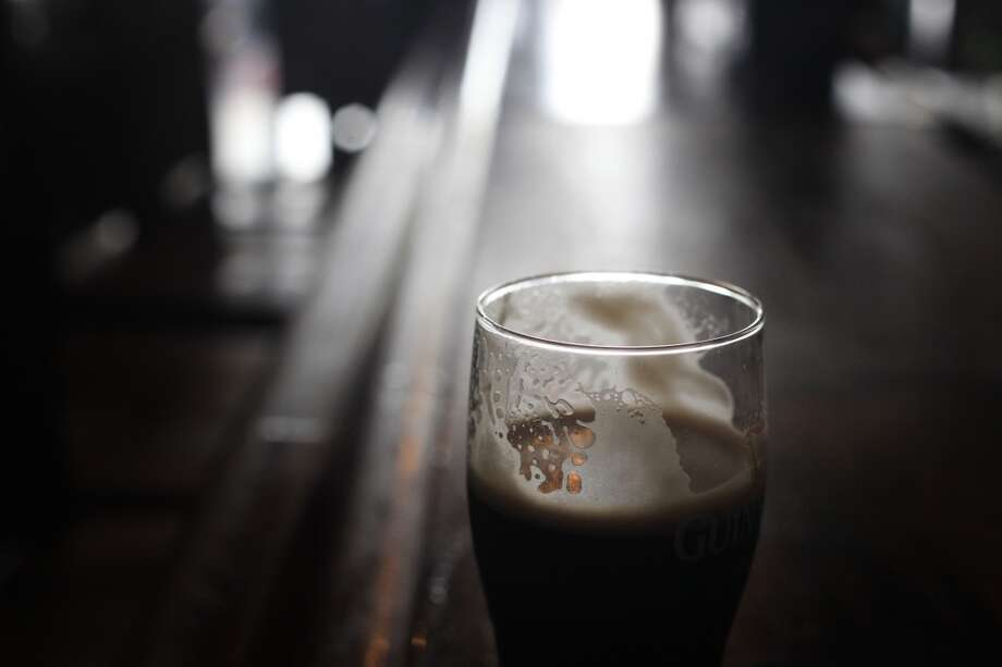 "Patrick ""Captain Cool"" LeBold's Guiness sits quietly on the bar at Maggie McGarrys on Grant Avenue in San Francisco. Photo: The Chronicle"