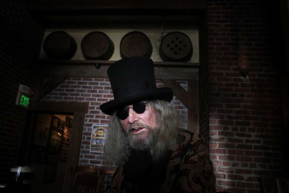 "Patrick ""Captain Cool"" LeBold sits in the quiet shadows at the end of the bar inside Maggie McGarrys. Photo: The Chronicle"