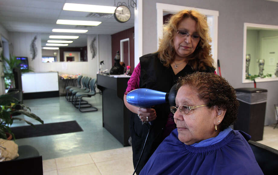 Monica Prater dries Luisa Longoria's hair Tuesday July 16, 2013 at Prater's newly opened business, Monica's Beauty Salon. Prater recently obtained a $170,000 Small Business Administration loan to help get her business started. Photo: John Davenport, San Antonio Express-News / SAN ANTONIO EXPRESS-NEWS