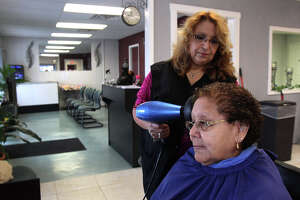 Monica Prater dries Luisa Longoria's hair Tuesday July 16, 2013 at Prater's newly opened business, Monica's Beauty Salon. Prater recently obtained a $170,000 Small Business Administration loan to help get her business started.