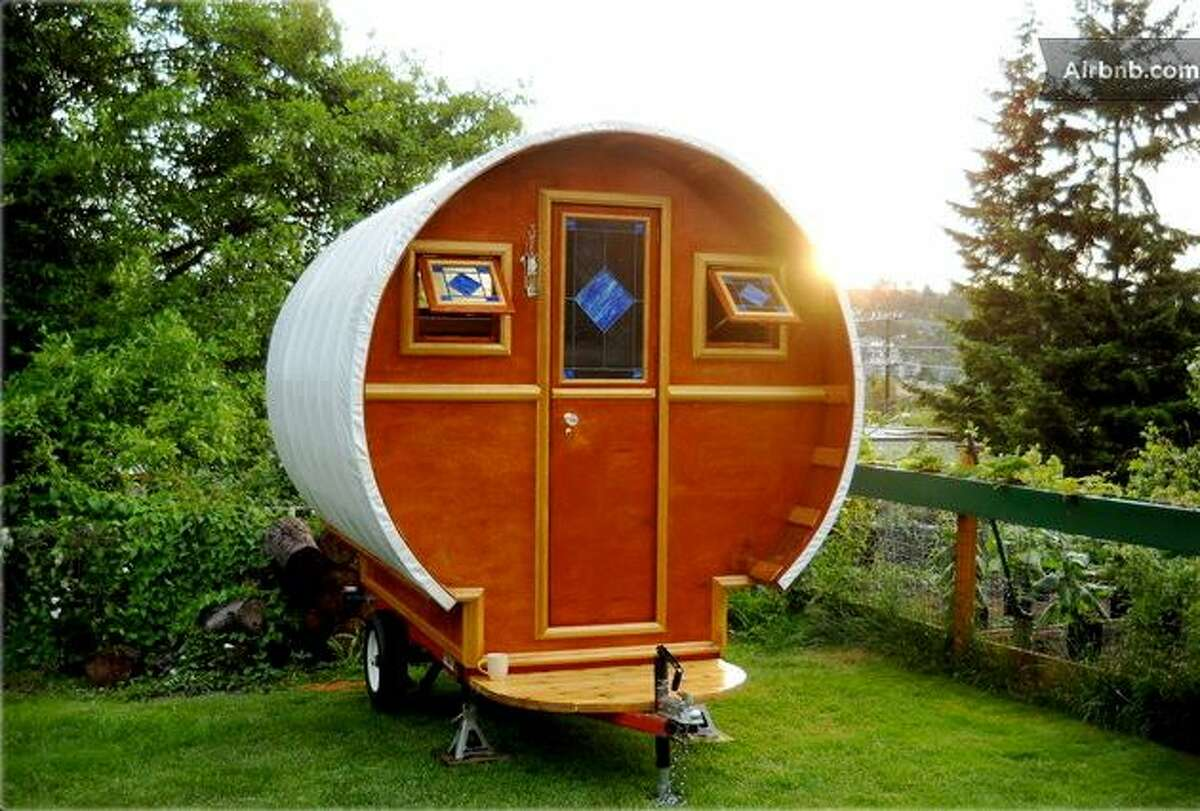"""""""Gypsy wagon"""" in Seattle Airbnb rentals in Seattle and the Northwest include all sorts of lodging, from boats and tree houses to the tiny, hand-crafted """"Gypsy wagon"""" in Queen Anne. It's parked in a grassy backyard and sleeps up to four people."""