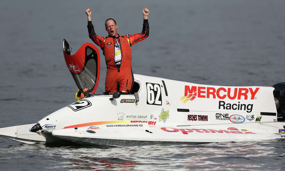Formula One driver Chris Fairchild throws up his arms after competing in a heat at the annual Seafair Weekend on Lake Washington. Photo: JOSHUA TRUJILLO, SEATTLEPI.COM / SEATTLEPI.COM