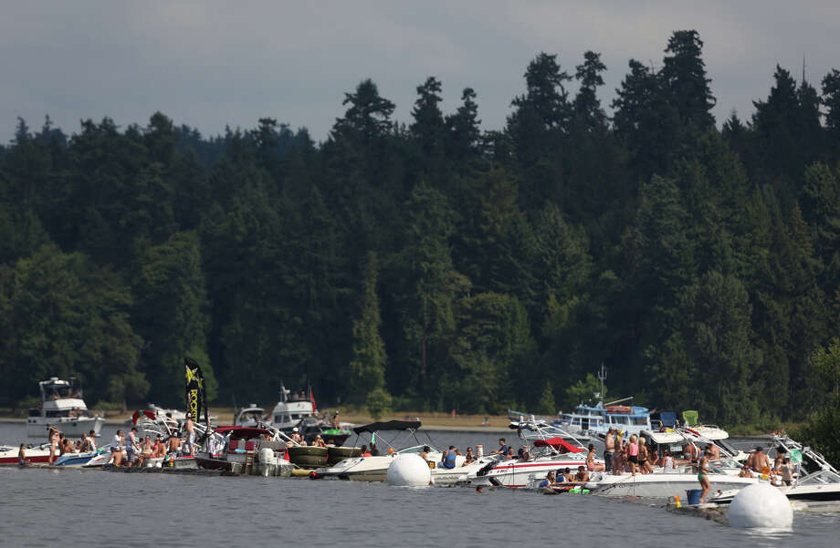 Boats line the log boom during the annual Seafair Weekend. Photo: JOSHUA TRUJILLO, SEATTLEPI.COM / SEATTLEPI.COM