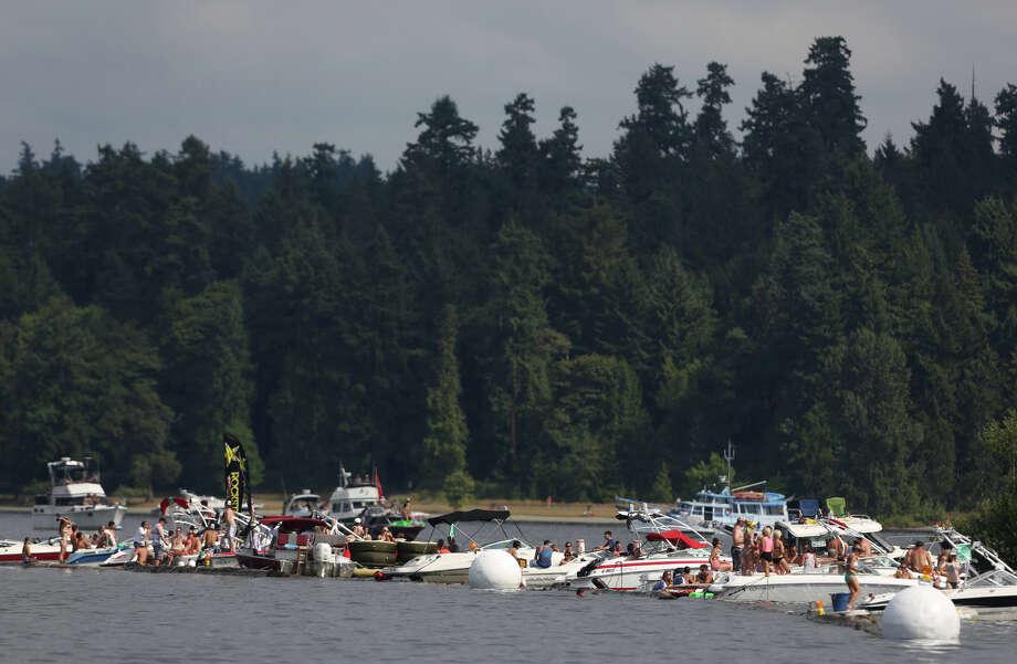 Boats line the log boom during the annual Seafair Weekend. Photo: JOSHUA TRUJILLO, SEATTLEPI.COM / SEATTLEPI.COM