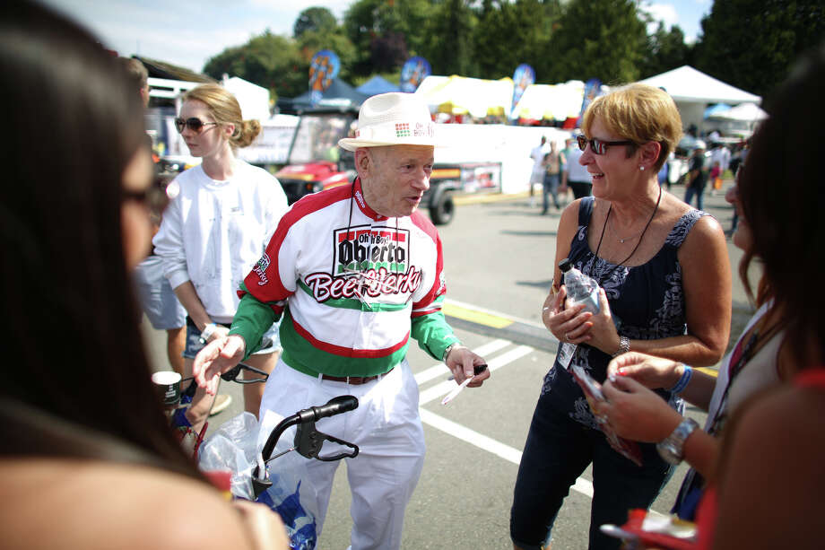 Art Oberto, founder of the beef jerky company, greets fans in the pits. Photo: JOSHUA TRUJILLO, SEATTLEPI.COM / SEATTLEPI.COM