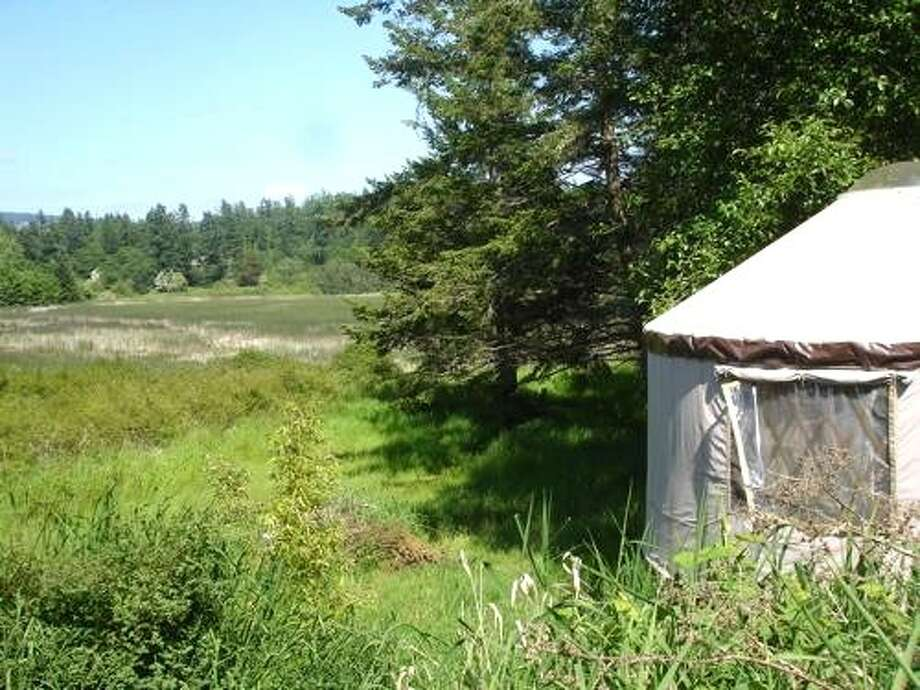 "Orcas Island horse farm yurtLike horses? Don't need electricity? This rustic yurt on a small horse farm on Orcas Island ""provides a back-to-nature experience with many of the comforts of home,"" writes Kate on Airbnb.  Photo: Via Airbnb"
