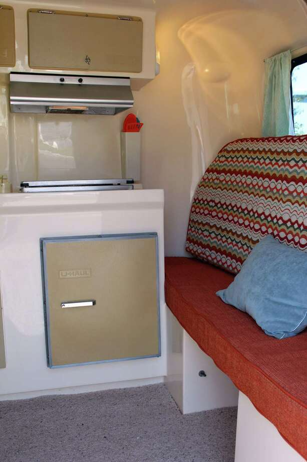 "U-Haul ""Dash"" has new upholstery and flooring, and comes with a sink, fridge and cooktop. The dining table converts to a bed for adults, and a couch becomes a bunk for kids. The listing is here.  Photo: Via Airbnb"