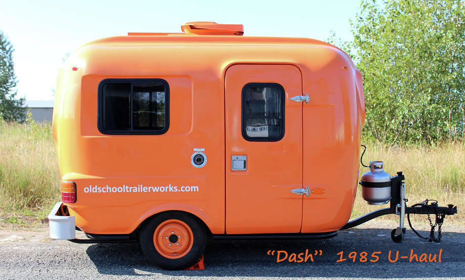 "Also available from Old School Trailer Works: This 1985 U-Haul named ""Dash."" It's 13 feet long, is available for tow-rentals and sleeps two adults and two small kids.  Photo: Via Airbnb"