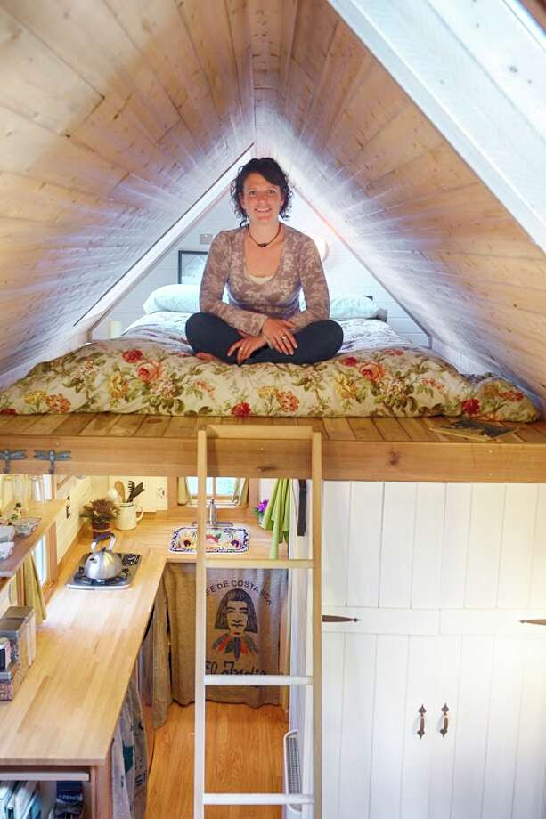 Here's owner and builder Brittany in the house's sleeping loft, which has a full-sized futon mattress. It sleeps two people. You can find the Airbnb listing here. Additional info is here. Photo: Via Airbnb / © 2012 Christopher Tack