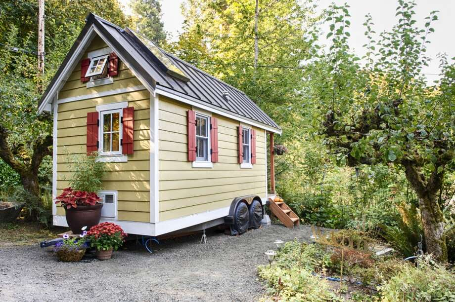 """Cozy Tiny House on Puget Sound""This tiny house in Olympia - just 100 square feet on the main floor - rests atop a flatbed trailer.  There's an additional 60 square feet for a sleeping loft.  Photo: Christopher Tack, Courtesy Bayside Bungalow, Via Airbnb"