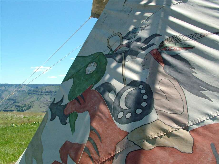 Native American-style paintings adorn the Warrior Tipi. It's located where Chief Joseph and his band of Nez  Perce once walked, says the Airbnb listing. You can find it here. Photo: Via Airbnb