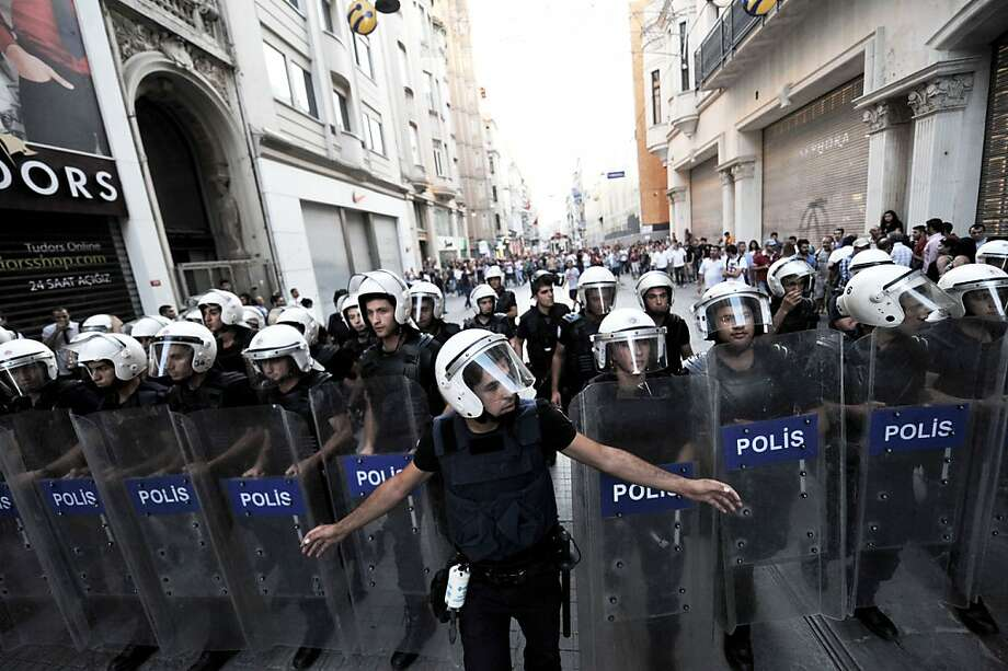 Turkish riot policemen try to disperse anti-goverment protestors during clashes at Istiklal street on August 3, 2013 in Istanbul. Turkish riot police on Saturday fired tear gas and water cannon to disperse hundreds of anti-government protesters at Istanbul's istiklal street most knowed shop avenue, the epicentre of violent demonstrations which rocked the country in June. AFP PHOTO / OZAN KOSEOZAN KOSE/AFP/Getty Images Photo: Ozan Kose, AFP/Getty Images