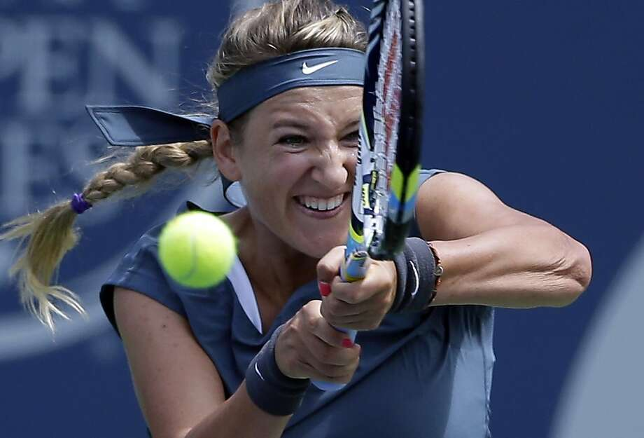 Victoria Azarenka, of Belarus, returns a serve from Ana Ivanovic, of Serbia, during their semifinal match at the Southern California Open tennis tournament, Saturday, Aug. 3, 2013, in Carlsbad, Calif. (AP Photo/Gregory Bull) Photo: Gregory Bull, Associated Press