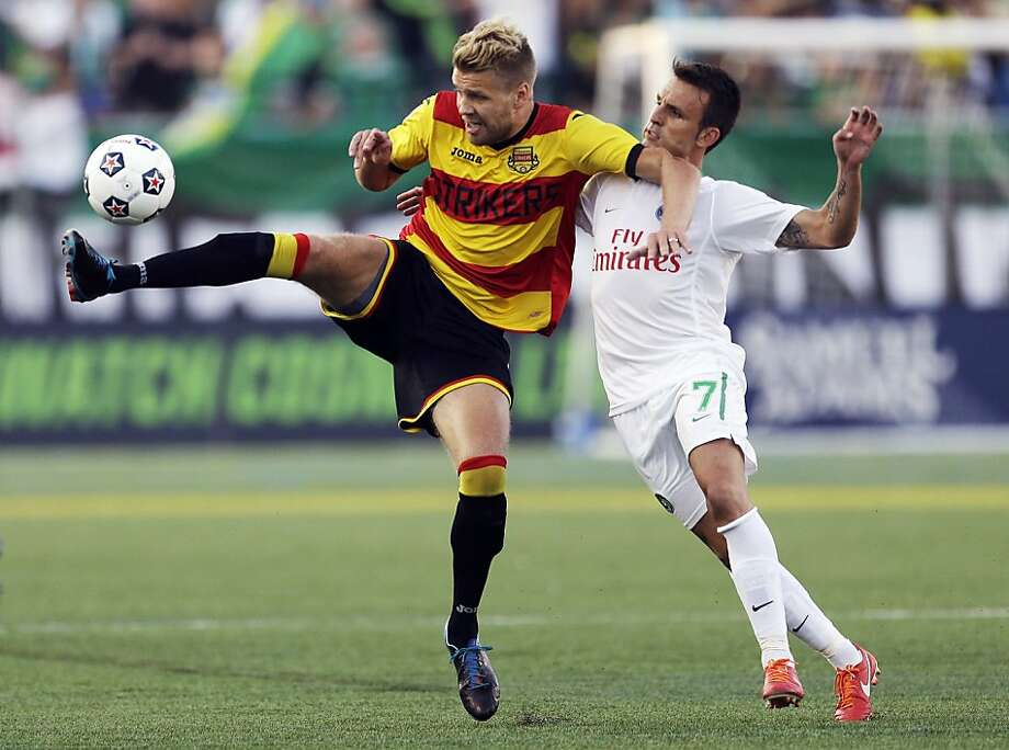 Fort Lauderdale Strikers' Toni Stahl, left, and New  York Cosmos' Ayoze fight for control of the ball during a soccer game, Saturday, Aug. 3, 2013, in Hempstead, N.Y. (AP Photo/Frank Franklin II) Photo: Frank Franklin II, Associated Press