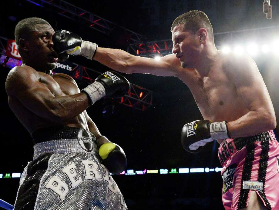 Jesus Soto Karass, right, of Mexico, punches Andre Berto during a welterweight title boxing match, Saturday, July 27, 2013, in San Antonio. Soto Karass won by TKO in the 12th round. (AP Photo/Darren Abate) Photo: Darren Abate, Associated Press / FR115 AP