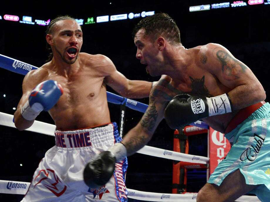 Diego Chaves, right, of Argentina, and Keith Thurman exchange punches during a welterweight title boxing match, Saturday, July 27, 2013, in San Antonio. Thurman won by KO in the 10th round. (AP Photo/Darren Abate) Photo: Darren Abate, Associated Press / FR115 AP