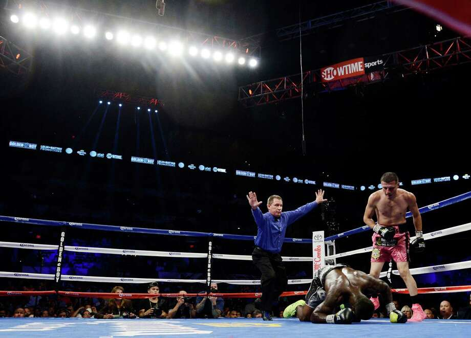 Andre Berto is knocked down by Jesus Soto Karass, right, of Mexico, during a welterweight title boxing match, Saturday, July 27, 2013, in San Antonio. Soto Karass won by TKO in the 12th round. (AP Photo/Darren Abate) Photo: Darren Abate, Associated Press / FR115 AP