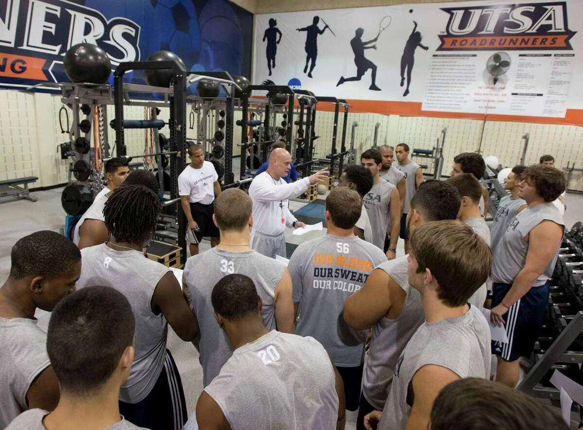 Head strength and conditioning coach Charlie Dudley, center, talks to football players during a UTSA football off-season strength training session, Friday, July 26, 2013, at UTSA in San Antonio.