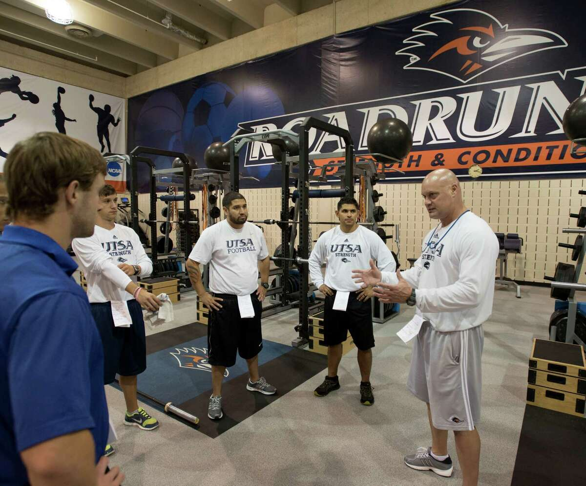 Head strength and conditioning coach Charlie Dudley, right, talks to student interns before a UTSA football off-season strength training session, Friday, July 26, 2013, at UTSA in San Antonio.