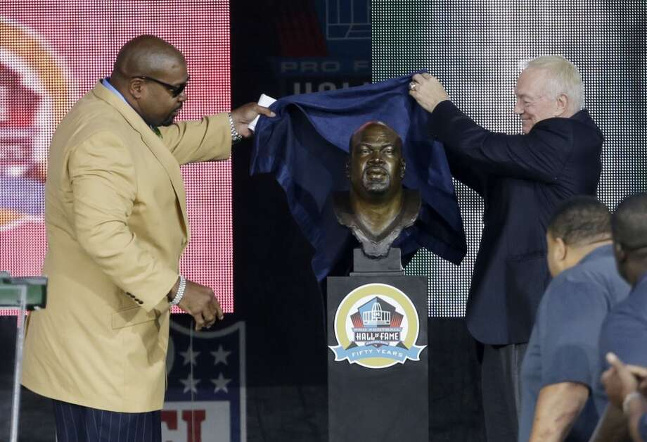 Former NFL football player Larry Allen, left, and Dallas Cowboys owner Jerry Jones unveil the bust of Allen during the induction ceremony at the Pro Football Hall of Fame Saturday, Aug. 3, 2013, in Canton, Ohio. (AP Photo/Tony Dejak) Photo: Tony Dejak, Associated Press