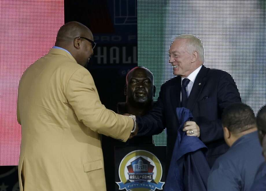 Former NFL football player Larry Allen, left, shakes hands with presenter Dallas Cowboys owner Jerry Jones during the induction ceremony at the Pro Football Hall of Fame Saturday, Aug. 3, 2013, in Canton, Ohio. (AP Photo/Tony Dejak) Photo: Tony Dejak, Associated Press