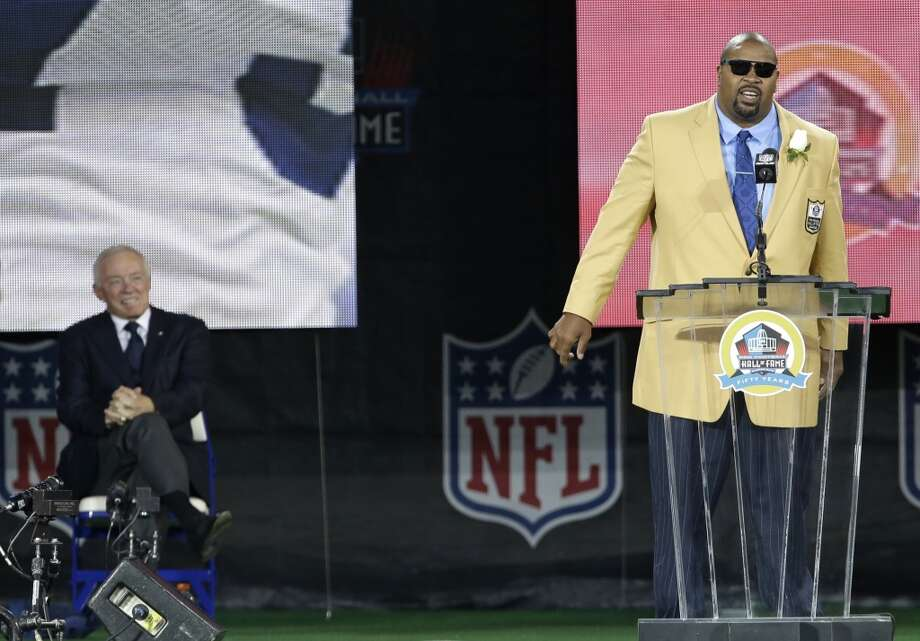 Former NFL football player Larry Allen, right, speaks during the induction ceremony as presenter Dallas Cowboys owner Jerry Jones, left, smiles at the Pro Football Hall of Fame Saturday, Aug. 3, 2013, in Canton, Ohio. (AP Photo/Tony Dejak) Photo: Tony Dejak, Associated Press