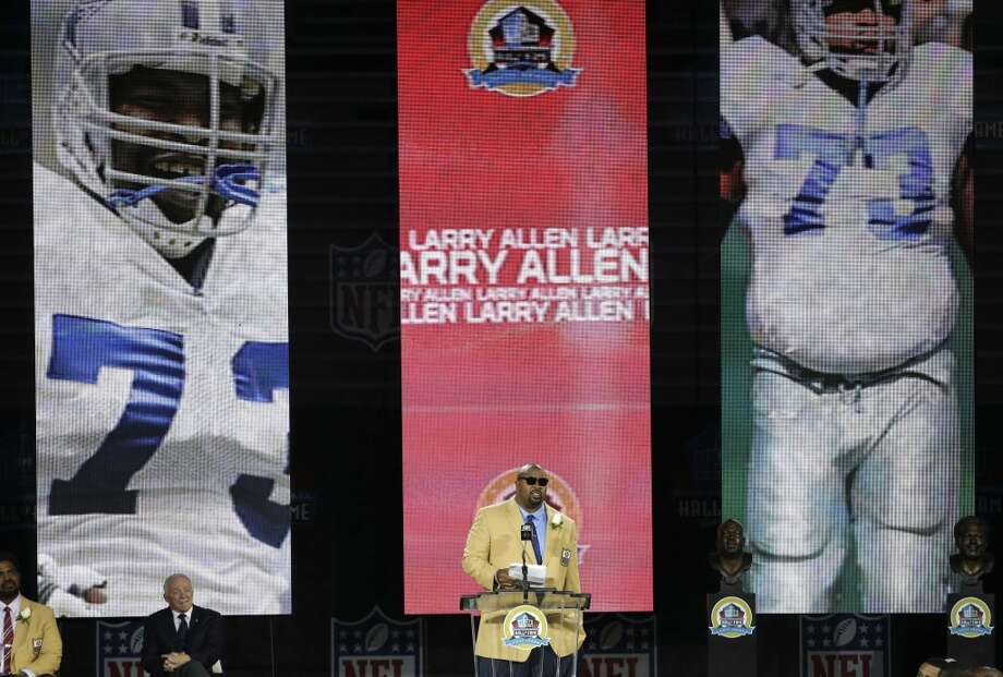 Former NFL football player Larry Allen speaks during the induction ceremony at the Pro Football Hall of Fame Saturday, Aug. 3, 2013, in Canton, Ohio. (AP Photo/Tony Dejak) Photo: Tony Dejak, Associated Press