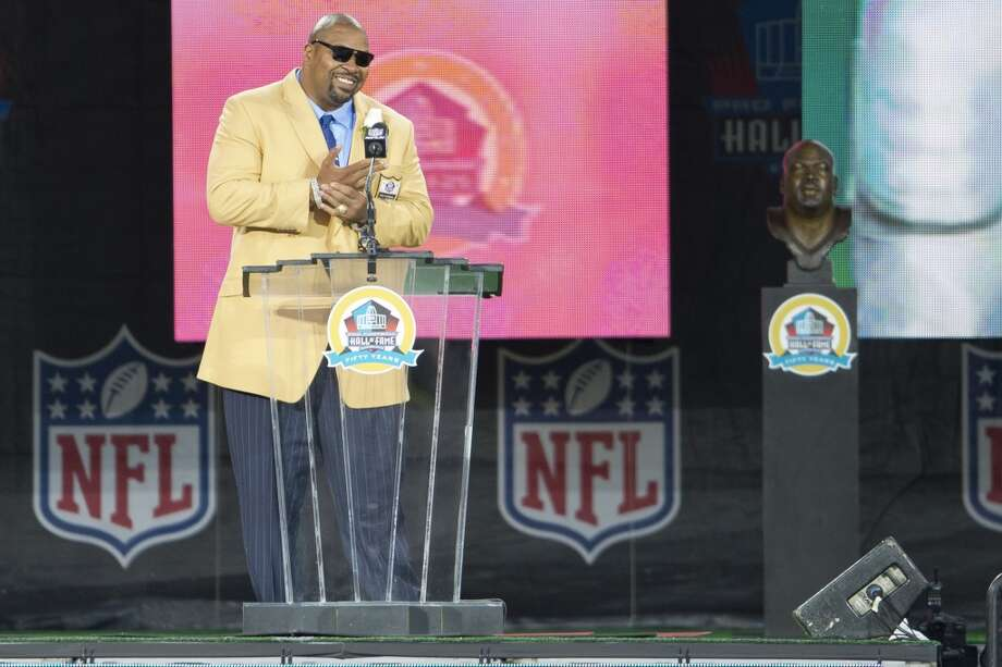 Former offensive Lineman Larry Allen of the Dallas Cowboys is presented with his Hall of Fame bust during the NFL Class of 2013 Enshrinement Ceremony at Fawcett Stadium on Aug. 3, 2013 in Canton, Ohio. (Jason Miller / Getty Images) Photo: Jason Miller, Getty Images