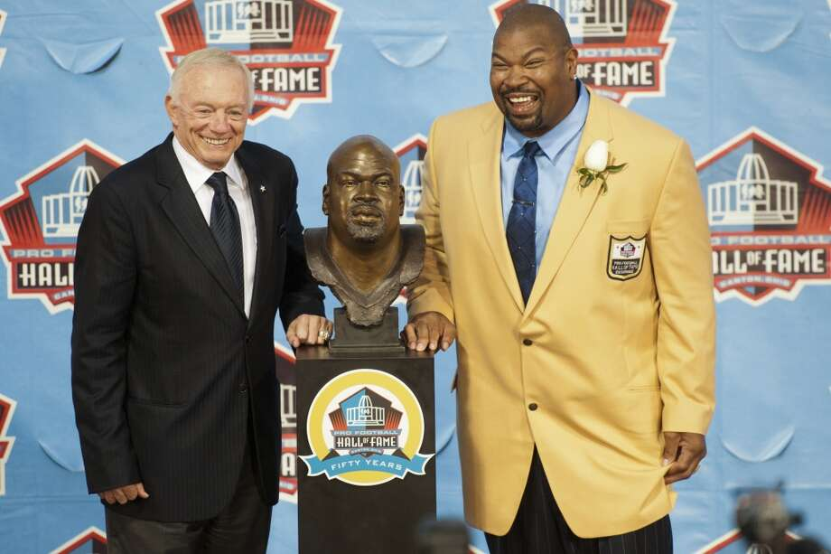 Dallas Cowboys Owner, President and General Manager, Jerry Jones (L) presents former offensive lineman Larry Allen of the Dallas Cowboys his Hall of Fame bust during the NFL Class of 2013 Enshrinement Ceremony at Fawcett Stadium on Aug. 3, 2013 in Canton, Ohio. (Jason Miller / Getty Images) Photo: Jason Miller, Getty Images