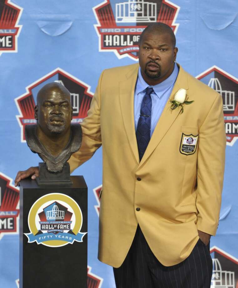 Hall of Fame inductee Larry Allen poses with his bust during the 2013 Pro Football Hall of Fame Induction Ceremony Saturday, Aug. 3, 2013, in Canton, Ohio. (AP Photo/David Richard) Photo: David Richard, Associated Press