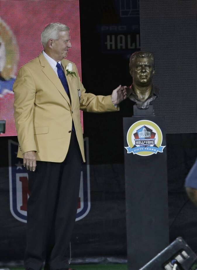 Former NFL football head coach Bill Parcells looks at his bust after the unveiling during the induction ceremony at the Pro Football Hall of Fame Saturday, Aug. 3, 2013, in Canton, Ohio. (AP Photo/Tony Dejak) Photo: Tony Dejak, Associated Press