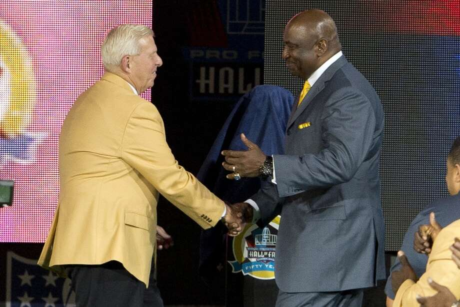 Former defensive end George Martin (R) of New York Giants presents former head coach Bill Parcells with his Hall of Fame bust during the NFL Class of 2013 Enshrinement Ceremony at Fawcett Stadium on Aug. 3, 2013 in Canton, Ohio. (Jason Miller / Getty Images) Photo: Jason Miller, Getty Images