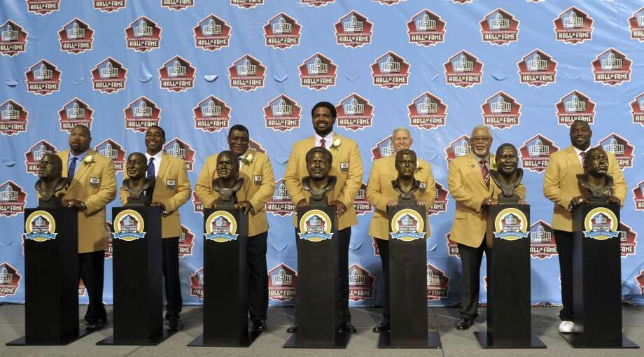 Hall of Fame inductees, from left,  Larry Allen, Cris Carter, Dave Robinson, Jonathan Ogden, Bill Parcells, Curley Culp and Warren Sapp pose with their bronze busts during the 2013 Pro Football Hall of Fame Induction Ceremony Saturday, Aug. 3, 2013, in Canton, Ohio. (AP Photo/David Richard) Photo: David Richard, Associated Press