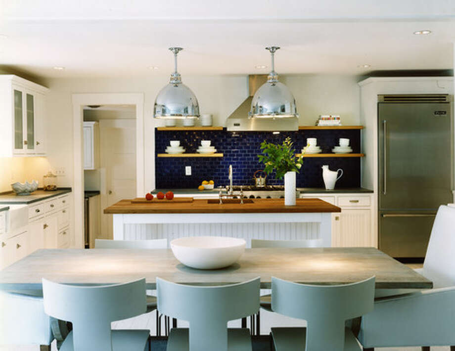 1. Glean inspiration from a spartan ship. This kitchen is clean and spare, which lets subtle marine accents like the chrome pendant lights, deep blue tile backsplash and light blue modern klismos chairs stand out. Photo: Houzz.com