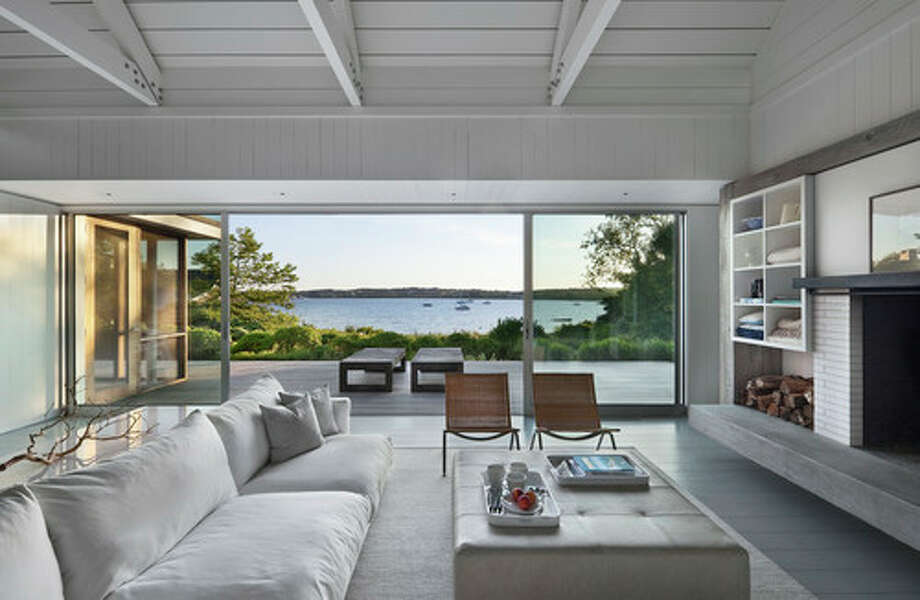 "4. Use a monochromatic palette. Going with a simple color scheme lets the natural materials and the views stand out. Driftwood, a found branch and wood trusses and planks add up to what Coastal Modern author Tim Clarke dubs ""Scandia Surf,"" a look that embraces pleasing proportions, uncluttered spaces and natural materials. Photo: Houzz.com"