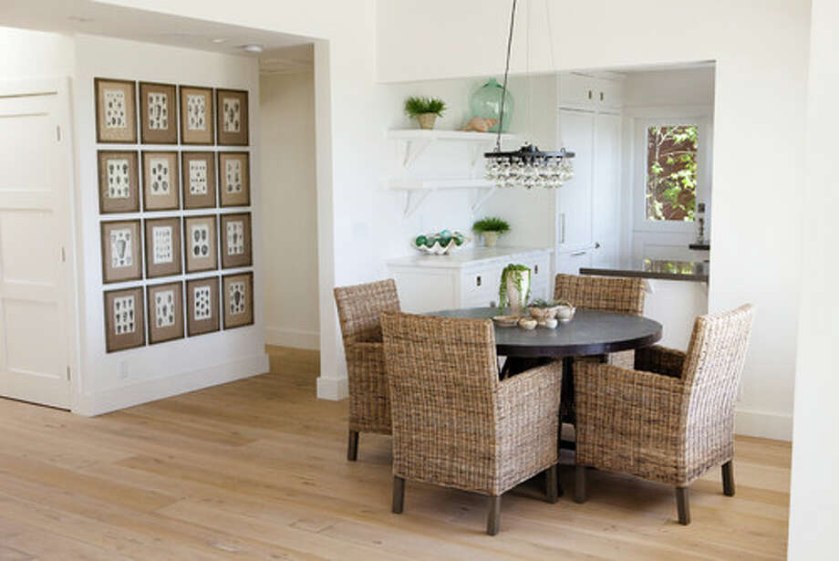 "9. By all means, keep your beachy textures. In this room streamlined wicker chairs, ""shelltanicals"" arranged in a grid and a stunning glass chandelier celebrate coastal materials. Items like glass floats and ship wheels can be used to add seaside accents to your modern decor. Photo: Houzz.com"